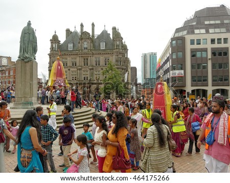 BIRMINGHAM UK - JULY 24: The cart festival called 'Ratha yatra' in Birmingham July 24, 2016. Children pull a small cart with small Jagannatha deities at around statue of Queen Victoria.