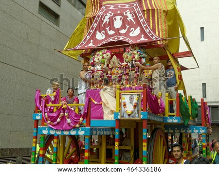 BIRMINGHAM UK - JULY 24: The cart festival 'Ratha yatra' in Birmingham July 24, 2016. The priests of the huge cart in a narrow Cannon Street gently hold the deity.