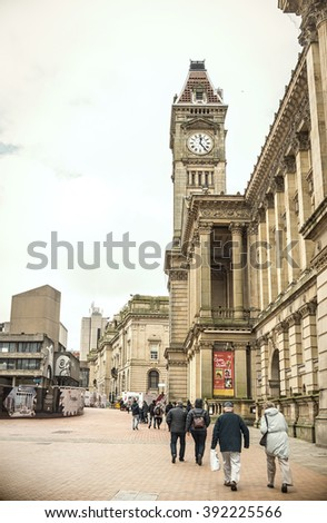 BIRMINGHAM, UK - MARCH 5 2016: People walk in the square, in the background the Birmingham Museum & Art Gallery - stock photo