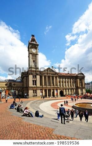 BIRMINGHAM, UK - MAY 14, 2014 - Museum, art gallery and clock tower in Chamberlain square, Birmingham, West Midlands, England, UK, Western Europe, May 14, 2014. - stock photo