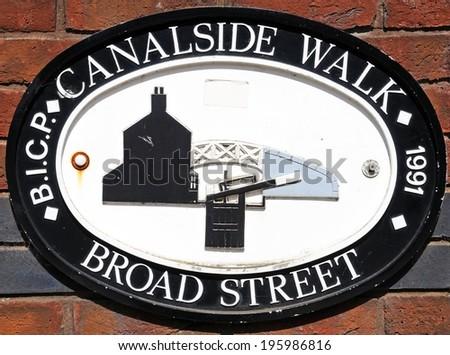 BIRMINGHAM, UNITED KINGDOM - MAY 14, 2014 - Broad Street canalside walk sign against a brick wall, Gas Street Canal Basin, Birmingham, West Midlands, England, UK, Western Europe, May 14, 2014. - stock photo