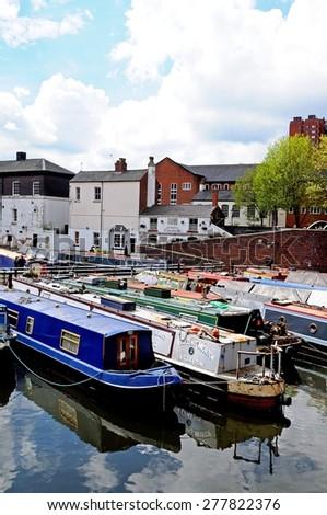 BIRMINGHAM, UNITED KINGDOM - MAY 14, 2014 - Narrowboats in Gas Street Canal Basin, Birmingham, West Midlands, England, UK, Western Europe, May 14, 2014. - stock photo