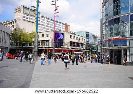 BIRMINGHAM, UNITED KINGDOM - MAY 14, 2014 - Shops along new street by the entrance to the Bullring shopping centre, Birmingham, West Midlands, England, UK, Western Europe, May 14, 2014. - stock photo