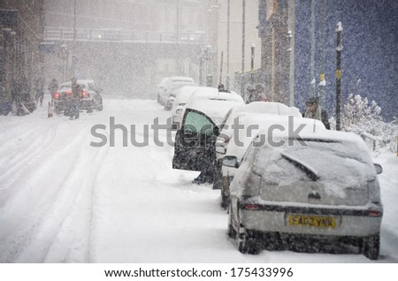BIRMINGHAM, UNITED KINGDOM - NOVEMBER 18, 2010: Staniforth street covered in snow during one of the 2010 winter which brought chaos across the UK. - stock photo