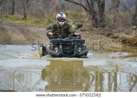 "Birobidzhan,Russia-may 2, 2015 : Birobidzhan, Russia-may 2, 2015 : the car is driven on the offroad on ""JPG orientation"""