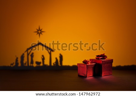 Birth Jesus silhouette of the crib in Bethlehem with present - stock photo
