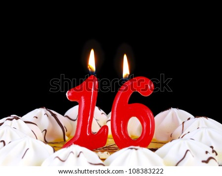 Birthday-anniversary cake with red candles showing Nr. 16 - stock photo