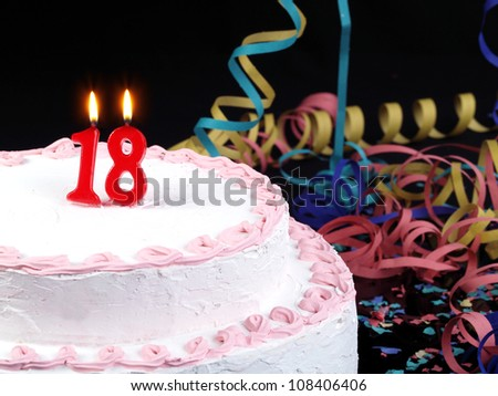Birthday-anniversary cake with red candles showing Nr. 18 - stock photo
