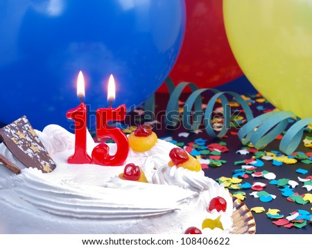 Birthday-anniversary cake with red candles showing Nr. 15 - stock photo