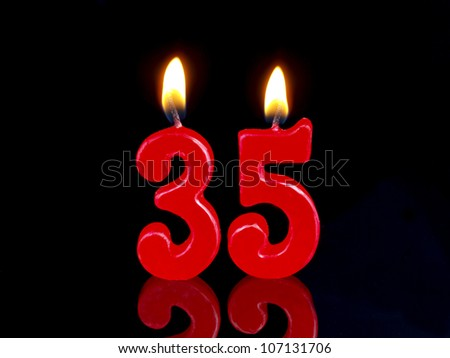 Birthday-anniversary candles showing Nr. 35 - stock photo