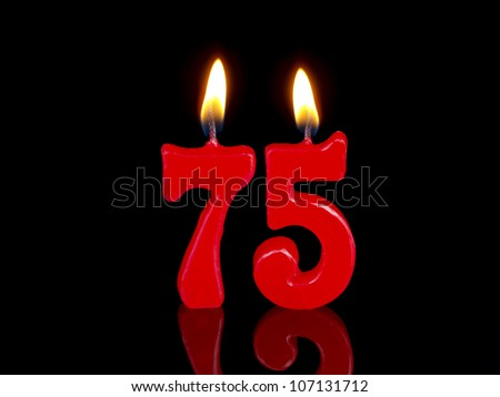 Birthday-anniversary candles showing Nr. 75 - stock photo