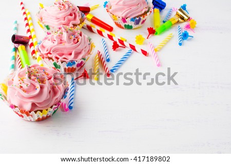 Birthday background with pink cupcakes. Birthday cupcakes. Homemade cupcake. Gourmet cupcakes. Sweet dessert. Sweet pastry. Birthday invitation. Birthday mockup. Styled desktop. Birthday background. - stock photo