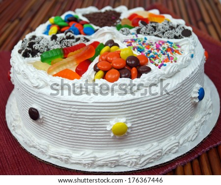 Birthday Cake.  A traditional frosted birthday cake decorated with assorted candy.   - stock photo