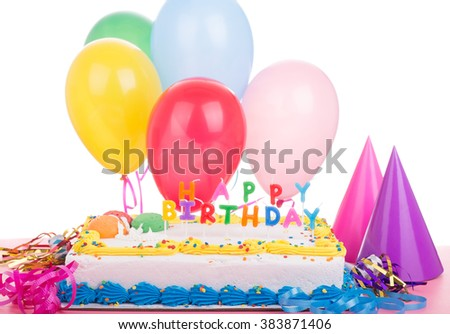 Birthday cake and decorations on a white background