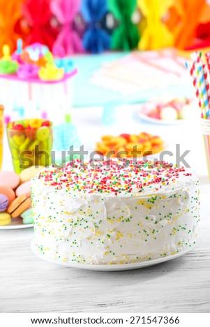 Birthday cake on colorful background - stock photo