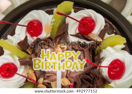 Birthday Cake On Perforated Metal Table Stock Photo 492977152
