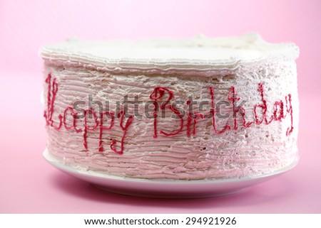 Birthday cake on pink background - stock photo