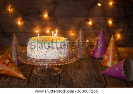 birthday cake on wooden table on light background - stock photo