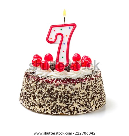 Birthday cake with burning candle number 7 - stock photo