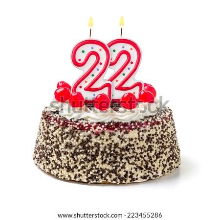 Birthday cake with burning candle number 22 - stock photo