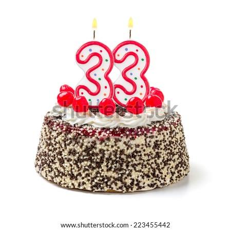 Birthday cake with burning candle number 33 - stock photo