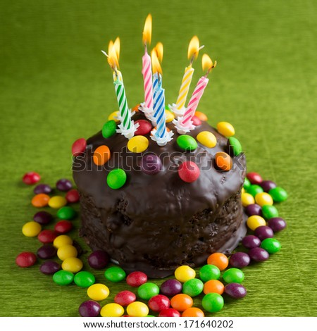 birthday cake with burning candles - stock photo