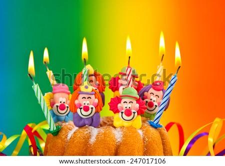 Birthday cake with burning candles decoration. Colorful festive background - stock photo