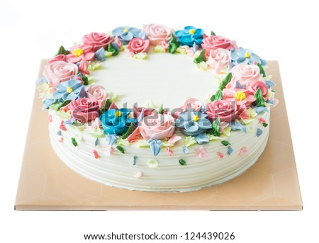Birthday cake with flowers on white - stock photo