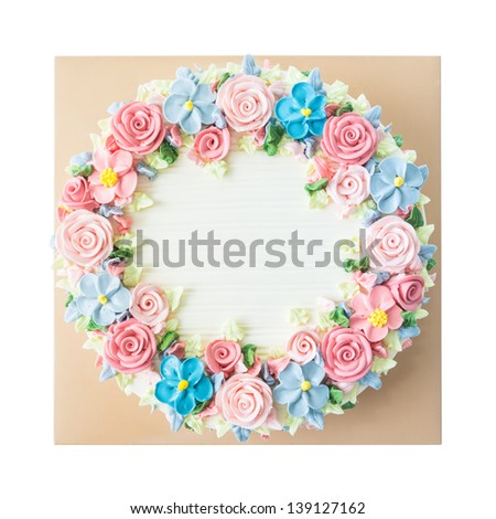 Birthday cake with flowers on white background - stock photo