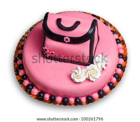 Birthday cake with pink frosting,decorated with a vintage woman handbag and flowers including three roses.White background. - stock photo