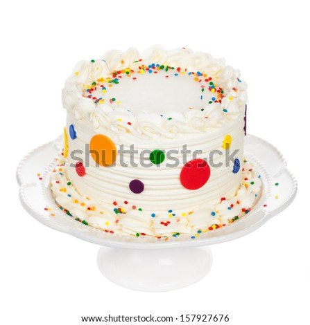 Birthday cake with polka dot fondant, buttercream icing and sprinkles isolated on white - stock photo