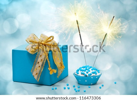 birthday cake with sparkler and  gift - stock photo