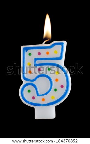 Birthday candle on black background, number 5  - stock photo