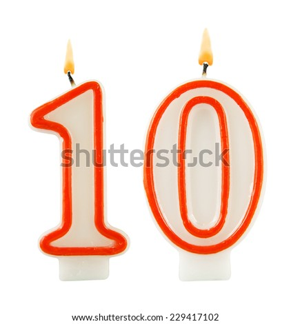Birthday candle on black background, number 10 - stock photo