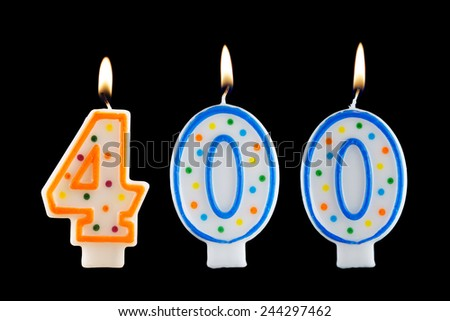 Birthday candle on black background, number 400  - stock photo