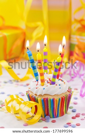 Birthday candle on colorful background