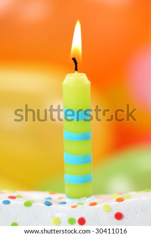 Birthday candle on colorful background - stock photo