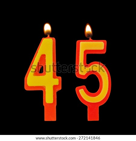 Birthday candles isolated on black background, number 45 - stock photo