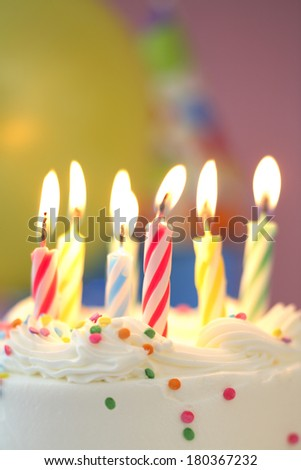 Birthday candles lit  - stock photo