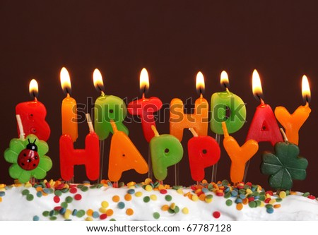 Birthday candles on brown background - stock photo