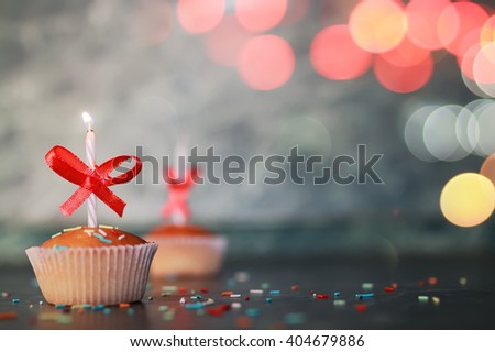 birthday cupcake with a candle bokeh - stock photo