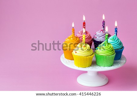 Birthday cupcakes on a cake stand - stock photo