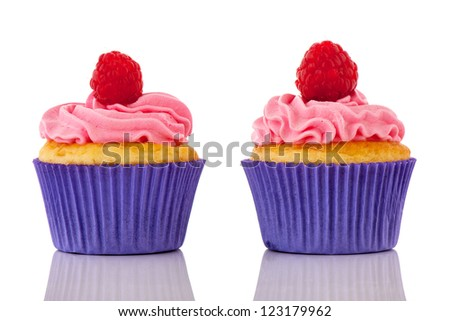 Birthday cupcakes with confetti and pink butter cream isolated over white background