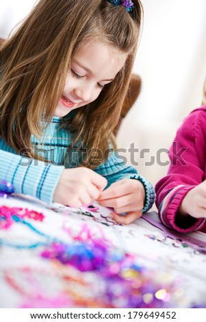 Birthday: Cute Girl Makes Birthday Craft - stock photo