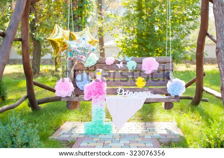 Birthday party decorations with ballons and big figure 1.Outdoor. Park. - stock photo