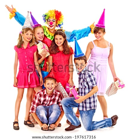 Birthday party group of teen people with clown. Isolated. - stock photo