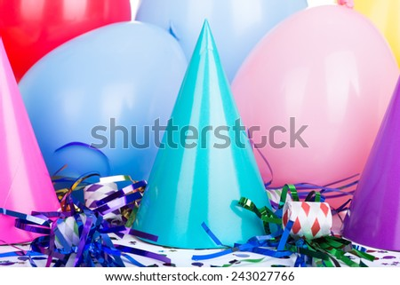 Birthday party hats with streamers and balloons - stock photo