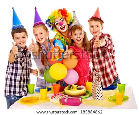 Birthday party of group teen with clown and cake. Isolated. - stock photo