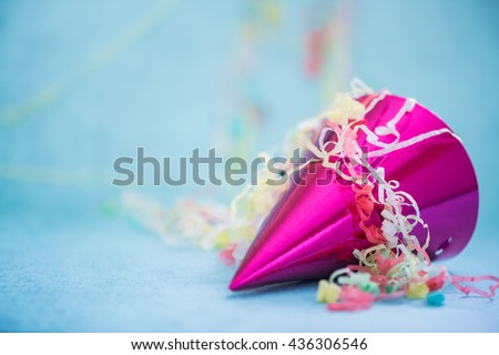 birthday party or new year celebration hat with confetti - stock photo