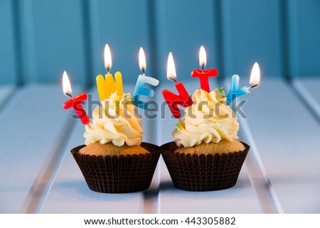 Birthday's cake - muffin with a candles for 20 - twentieth birthday . Happy birthday !